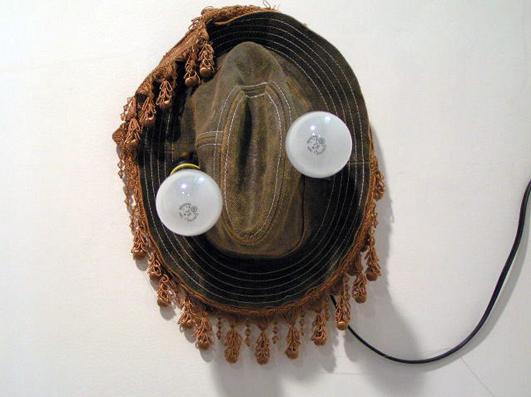 Chris Domenick. Leather hat, curtain tassles, lightbulbs.
