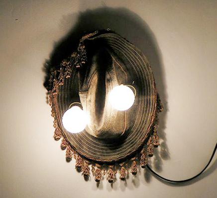 Chris Domenick. Leather hat, curtain tassles, lightbulbs, electricity.