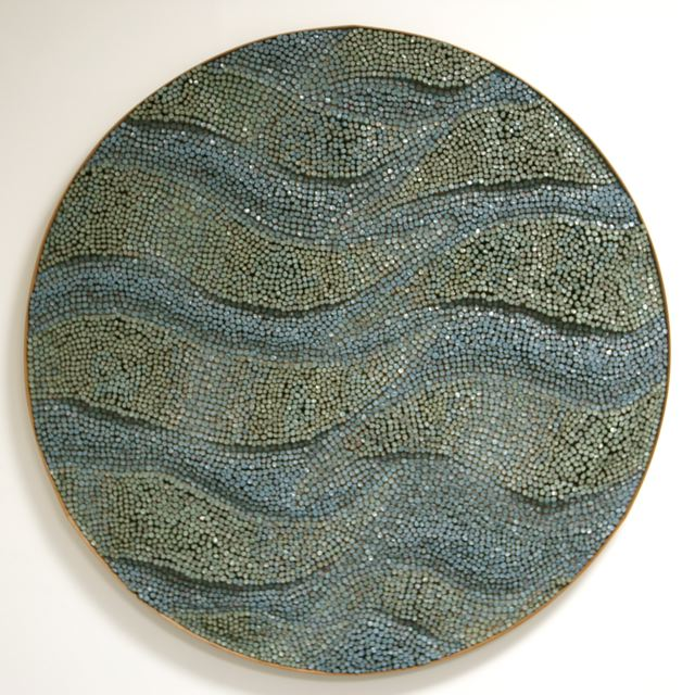 "Brigitte Bouquet. Watching Waves, 2009. ceramic, hessian, wood. 120\"" diameter."